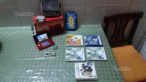 Nintendo 3ds rossa con giochi