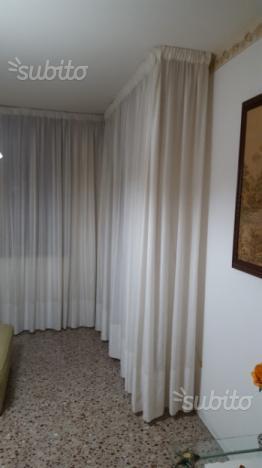 Tenda angolare x un intera camera da soggiorno