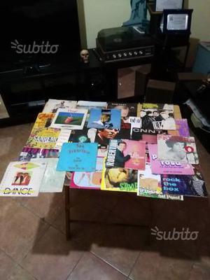 Lotto di 48 dischi vinile 45 giri vario genere in