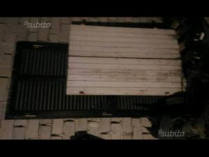 Sportelloni scuri in legno massello persiane