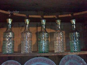 Serie di 5 bottiglie di vino anni 50 in vetro