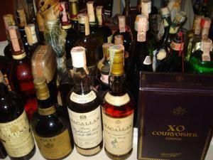 Cerco acquisto vecchie bottiglie Whisky Cognac Rhum Boubon