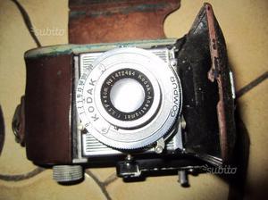 Gruppo di tre macchine fotografiche tradizionali