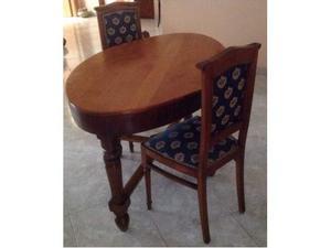 Tavolo ovale in noce massello con sedie