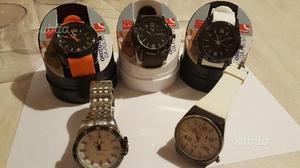 3 orologi unisex nuovi 10 l'uno + 2 omaggio