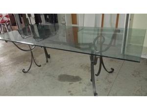 Tavolo in cristallo con base in ferro battuto