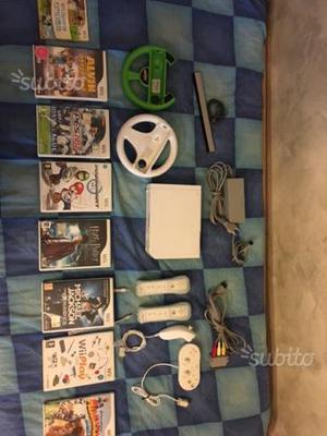 Nintendo Wii + giochi e telecomandi