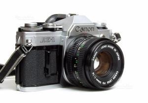 Canon AE-1 con 2 obiettivi Canon FD e accessori