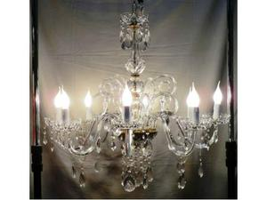 Lampadario a 8 luci in cristallo con pastorali e strass.