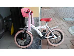 Vendo bicicletta da bambina 2_5 anni con rotelle. Come