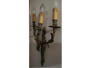 Appliques in bronzo, a tre luci