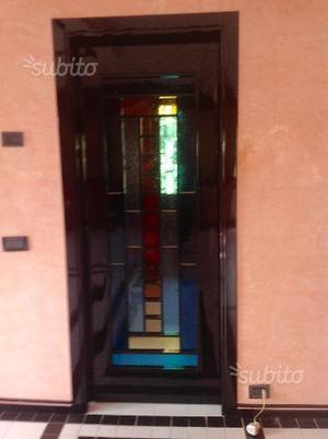 Porte da interno in legno con inserti in vetro