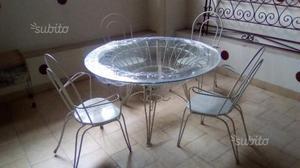 Tavolo da giardino in vetro e ferro battuto