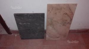 6 lastre in marmo ed una in pietra
