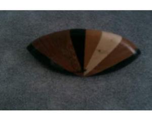 Fermacapelli in legno