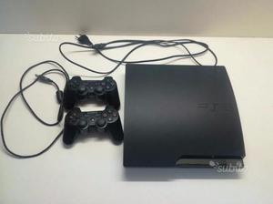 PS3 slim + 2 pad + 2 microfoni + giochi