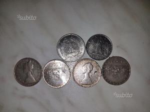 Sono 4 monete di 500 lire con testa e croce allinv