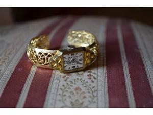 Vecchio orologio giocattolo in latta elegante dorato vintage
