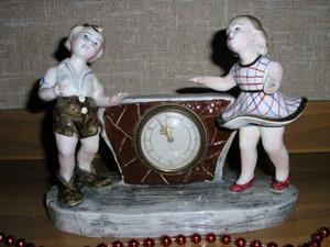 Splendido orologio anni'50 con coppia di personaggi in