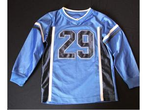 T-shirt sport marca TKS blu e nero bimbo 7 anni