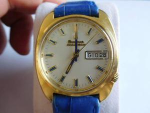 Orologio bulova accutron placcato oro con trizi blu