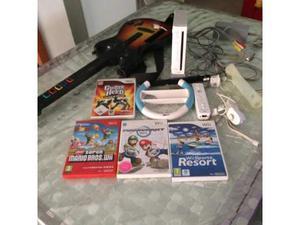 Wii con giochi e chitarra Guitar Hero Usato