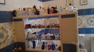 Miniature di bottigliette di profumi