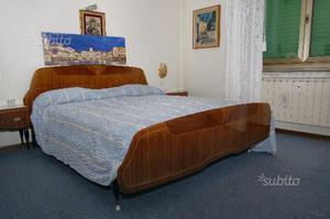 Camera da letto vintage della metà degli anni '60
