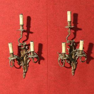 Coppia di appliques francesi in bronzo dorato