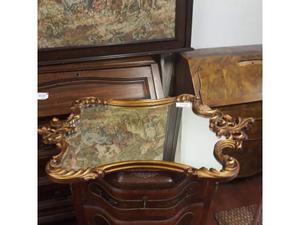 Specchio entro cornice in legno lavorata - dorata -