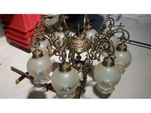 Lampadario anno  in bronzo a 8 palle vetro satinato