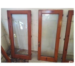 Vendo 4 finestre in legno a 2 ante e 2 porte con 2 ante