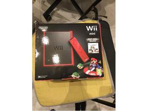 Wii mini + 6 giochi + 3 telecomandi + 1 Nunchuk