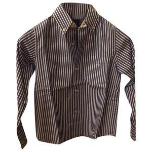 camicia a righe bianche e azzurre