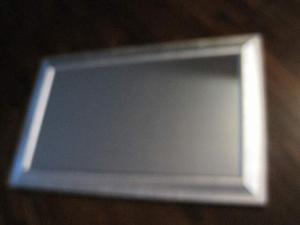 Specchio con cornice in legno argentata