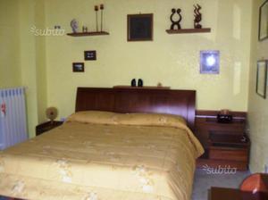 Camera da letto in ciliegio massello