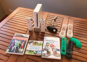 Nintendo Wii + Wii fit balance board + 4 giochi