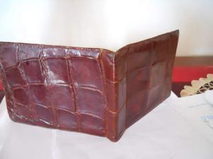 Portafoglio pelle di coccodrillo posot class for Portafoglio gucci vero o falso