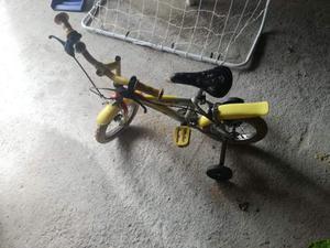 Bicicletta bambino o bambina con rotelle
