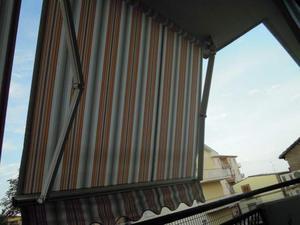 Tenda da sole per balcone a rullo, bracci retrattili
