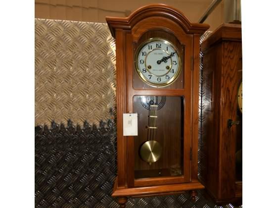 Orologio a pendolo in legno Victime carica manuale