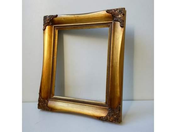 Cornice in legno color oro