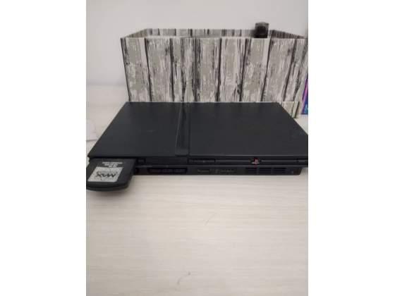 PlayStation 2 Slim + giochi e accessori