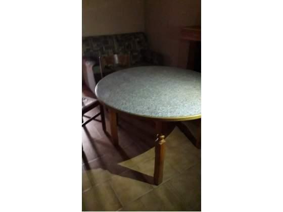 Vendo tavolo usato rotondo allungabile più 4 sedie