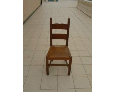 Sedia in legno massello e pelle