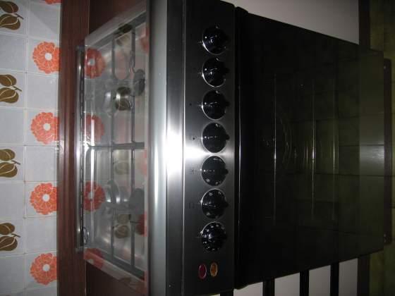 Cucina a gas 4 fuochi con forno elettrico
