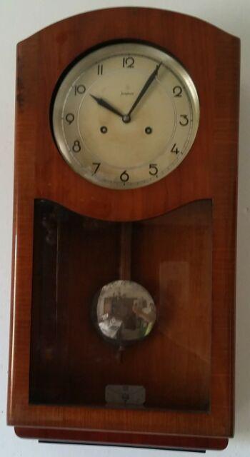 Orologio a parete con pendolo della junghans