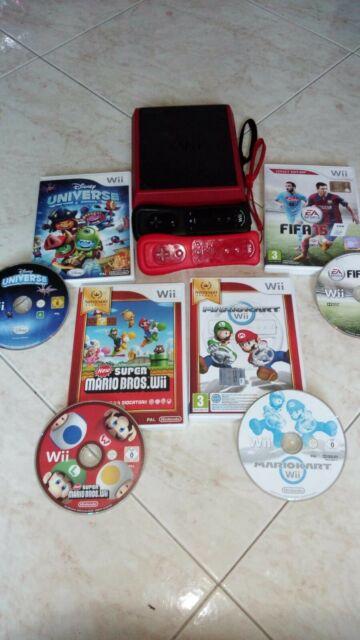 Wii con 4 giochi originali e joystick grandi e piccoli