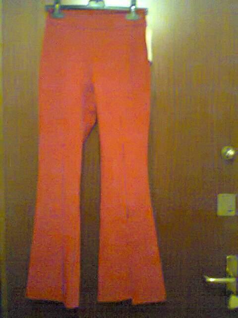 Pantaloni color rosso nuovi tg S con spacchi