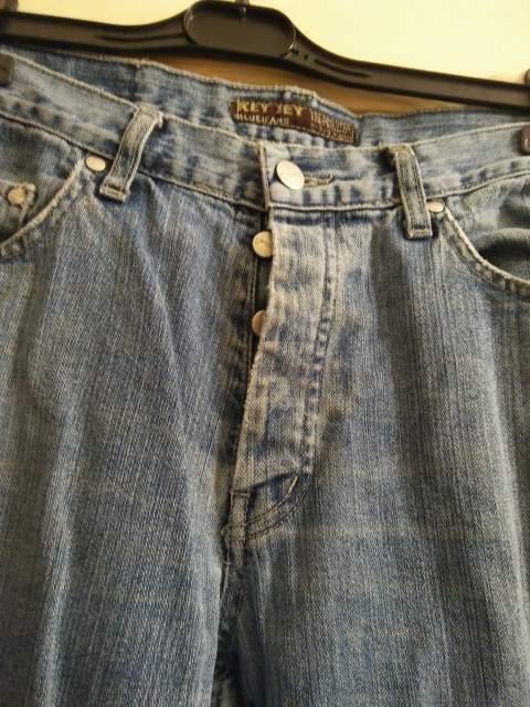 Pantaloni jeans con bottono taglia 48